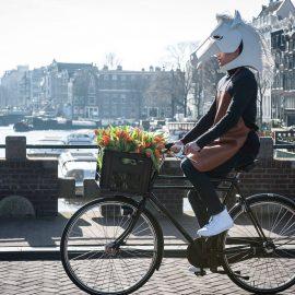 Models at Work - Promotie host voor Hermѐs festival des Metiers op fiets over grachten Amsterdam
